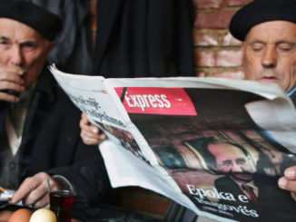 Old Men Read Newspapers in Kosovo