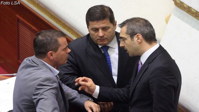 Armando Prenga with MP Pjerin Ndreu and Interior Minister Saimir Tahiri in Parliament