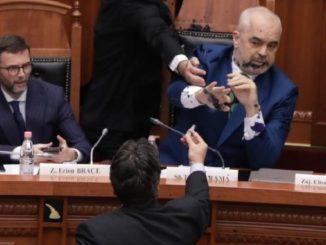 Edi Paloka sprays ink on PM Edi Rama